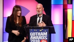 """The Rider"" producers Mollye Asher, left, and Bert Hamelinck, accept the Best Feature Film award at the 28th annual Independent Filmmaker Project's Gotham Awards on Nov. 26, 2018, in New York."
