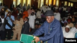 Nigeria's President Goodluck Jonathan presents the 2013 budget proposal at a joint sitting of the parliament in the capital Abuja October 10, 2012.