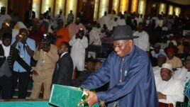 Nigeria's President Goodluck Jonathan presents the 2013 budget proposal at a joint sitting of the parliament in Abuja, October 10, 2012.