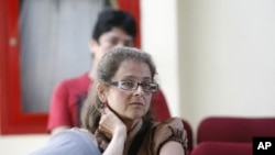 Lori Berenson sits in a migration office in Lima December 19, 2011.