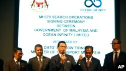 Malaysian Minister of Transport Liow Tiong Lai, center, speaks at a press conference during MH370 missing plane search operations signing ceremony between the government of Malaysia and the Ocean Infinity Limited in Putrajaya, Malaysia, Jan. 10, 2018.