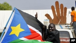 A Sudanese man cheers during a demonstration in support of the referendum on southern independence during a rally organized by the Southern Sudan Referendum Bureau in Juba, 07 Jan 2011.