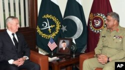 FILE - U.S. Defense Secretary James Mattis, left, meets with Pakistan's army chief Gen. Qamar Javed Bajwa in Rawalpindi, Pakistan, Dec. 4, 2017.