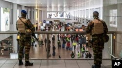 Soldiers patrol in the departure terminal, during the one-year anniversary service at Zaventem Airport in Brussels, March 22, 2017. The suicide bombings at the Brussels airport and subway on March 22, 2016, killed 32 people and wounded more than 300 other