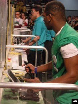 Students at the controls, trying to get their robots to kick a soccer goal.
