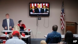Supporters watch President Donald Trump speak at a State of the Union watch party hosted by the Hamilton County Republican Party, Jan. 30, 2018, in Cincinnati.