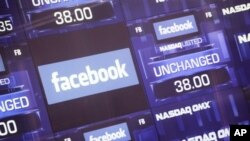 A screen at NASDAQ in New York City lists Facebook on its first day of public trading.