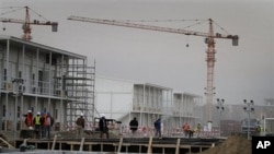 FILE - Workers are seen at an area under construction at the U.S. embassy in Kabul, Afghanistan, April 4, 2012.