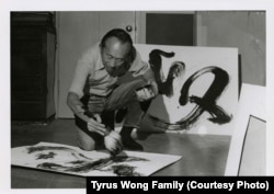 Tyrus Wong works on a calligraphic painting at his studio.