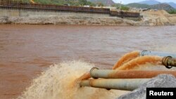 FILE - Water gushes out from pipes by the construction of Ethiopia's Great Renaissance Dam in Guba Woreda, some 40 kilometers from Ethiopia's border with Sudan.