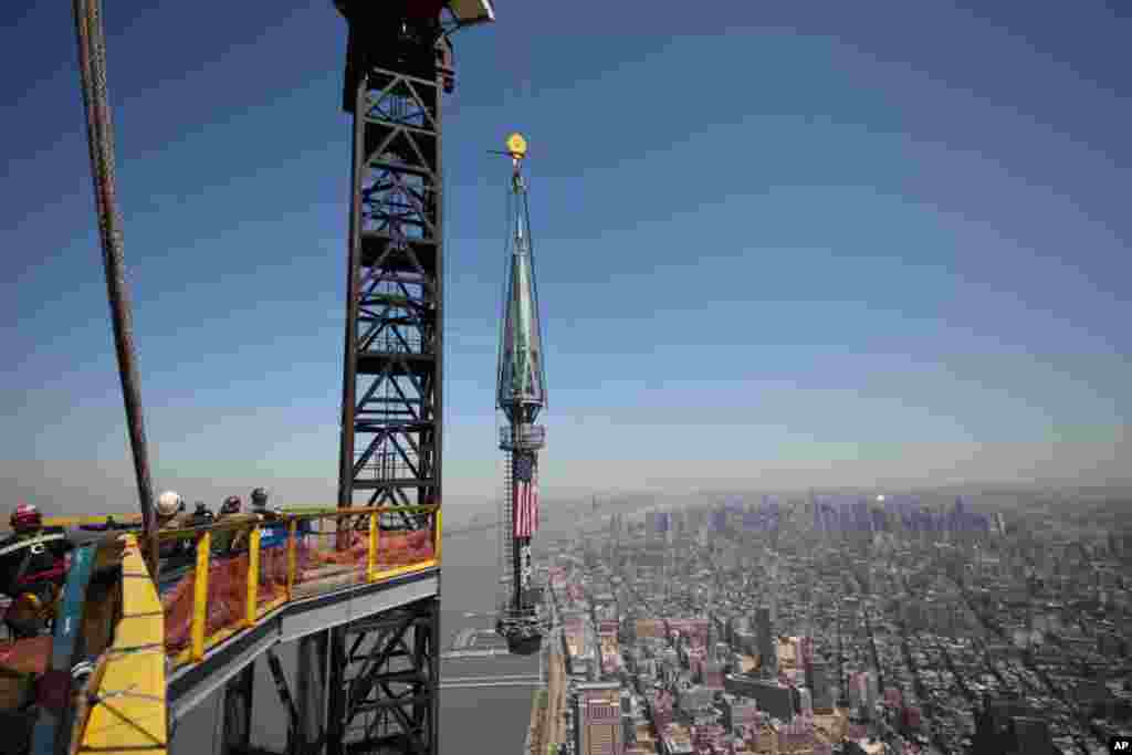 One of the last two segments of the spire is hoisted to the top of One World Trade Center, May 2, 2013.