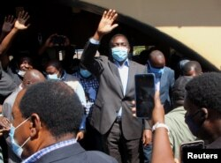 Opposition UPND party's presidential candidate Hakainde Hichilema waves to supporters after casting his ballot in Lusaka, Zambia, August 12, 2021. REUTERS/Jean Ndaisenga