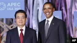 美国总统奥巴马和中国国家主席胡锦涛11月12日在檀香山