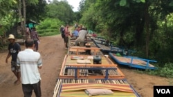 Some bamboo trains are in line for departure, in Battambang, on July 21, 2017. (Sun Narin/VOA Khmer)