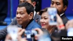 Philippine President Rodrigo Duterte arrives at an event with Filipino community in Hong Kong, April 12, 2018. Philippine President Rodrigo Duterte has threatened to arrest an International Criminal Court (ICC) prosecutor if she conducts activities in his country.