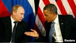 Tổng thống Mỹ Barack Obama và Tổng thống Nga tại một cuộc họp bên lề hội nghị G8. (Reuters/ Jason Reed)