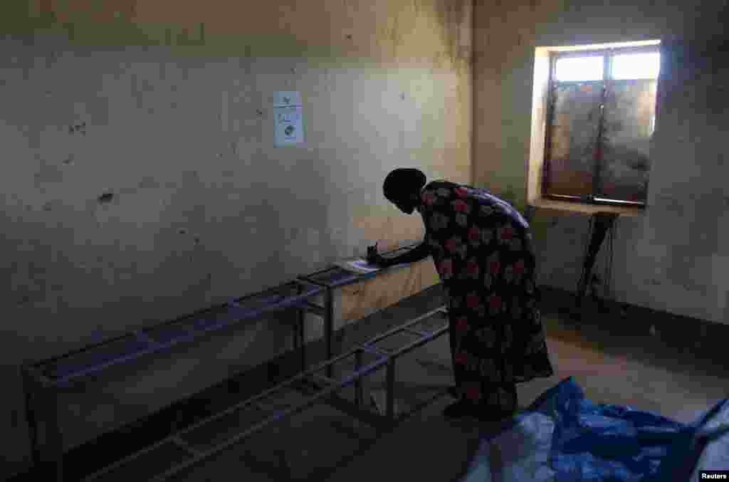 A woman votes in a polling station during a referendum in the town of Abyei, Oct. 28, 2013.