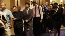 Job seekers wait in line to enter a job fair on September 1 in San Mateo, California