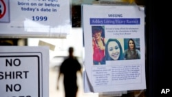 A missing poster for Ashley HeavyRunner Loring is posted to the entrance of a grocery store on the Blackfeet Indian Reservation in Browning, Mont., July 12, 2018.