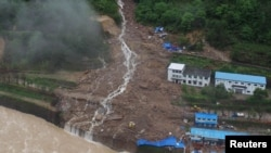 An aerial view shows that buildings at a hydroelectric power station under construction that were hit by landslide in Sanming, Fujian province, China, May 8, 2016.