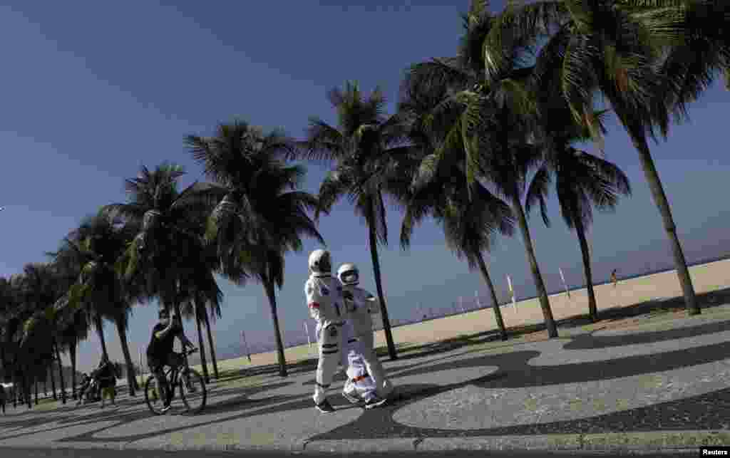 Tercio Galdino, 66, and his wife Aliceia, 65, wearing their protective 'space suits', walk on the sidewalk of Copacabana Beach amid the outbreak of the COVID-19 in Rio de Janeiro, Brazil, July 11, 2020.