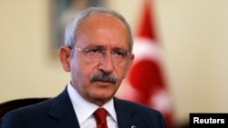 FILE - Kemal Kilicdaroglu, who heads Turkey's main opposition Republican People's Party (CHP), sounds skeptical that a ruling coalition will form.