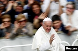 Pope Francis waves as he leaves at the end of a Jubilee mass in Saint Peter's Square at the Vatican, April 3, 2016.
