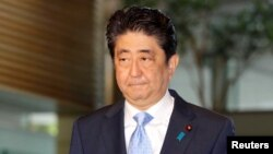 FILE - Japan's Prime Minister Shinzo Abe arrives at his official residence in Tokyo, Japan, in this photo taken by Kyodo, May 14, 2017, after South Korea's military said that North Korean had fired an unidentified projectile from a region near its west coast.