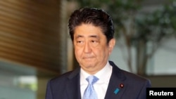 Japan's Prime Minister Shinzo Abe arrives at his official residence in Tokyo, Japan, in this photo taken by Kyodo, May 14, 2017, after South Korea's military said that North Korean had fired an unidentified projectile from a region near its west coast.
