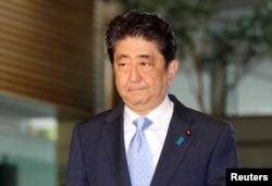 Japan's Prime Minister Shinzo Abe arrives at his official residence in Tokyo, Japan, in this photo taken by Kyodo, May 14, 2017, after South Korea's military said that North Korean had fired an unidentified projectile from a region near its west coast. (Kyodo/via REUTERS)