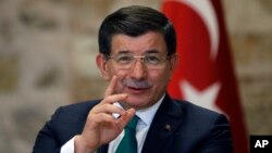 Turkish Prime Minister Ahmet Davutoglu speaks to a group of foreign reporters in Istanbul, Dec. 9, 2015. Turkey claims vindication for sending troops and tanks into Iraq, following an attack on a Turkish base training Iraqis who are fighting Islamic State.