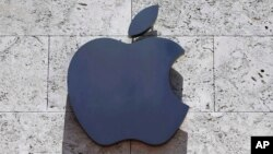FILE - The Apple logo is seen at a store in Miami Beach, Florida, Aug. 8, 2017.