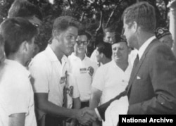 When he was in high school, Clinton met President John F. Kennedy at the White House.