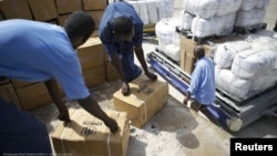 Workers unload emergency aid from a UNHCR-chartered aircraft in Mogadishu, August 8, 2011.