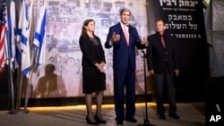 Secretary of State John Kerry, accompanied by Dalia Rabin-Pelossof, daughter of assassinated Israeli Prime Minister Yitzhak Rabin and Tel Aviv Mayor Ron Huldai, speaks at the site of Rabin's death after a wreath laying in Tel Aviv, Nov. 5, 2013.