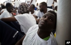 FILE-An African migrant rests after being rescued in a rescue operation, on the Aquarius vessel of SOS Mediterranee NGO and MSF (Doctors Without Borders) in the international waters some 25 Nautical miles (29 miles, 46 kilometers) north of the Libyan coas