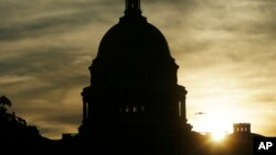 FILE - The sun rises over the U.S. Capitol in Washington, Sept. 24, 2013.