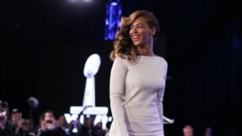 Recording artist Beyonce walks offstage after the halftime show press conference ahead of the NFL's Super Bowl XLVII in New Orleans, Louisiana, Jan. 31, 2013.