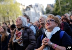 People attend the Chrism Mass, as part of the Holy Week, at the Saint Sulpice Church in Paris, France, April 17, 2019.