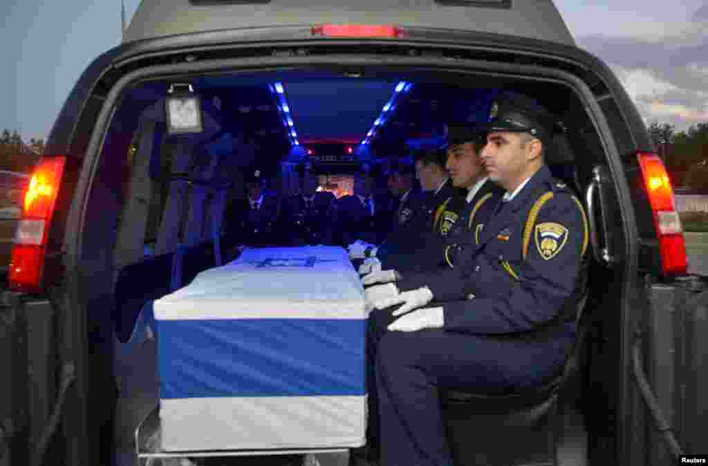 The coffin of former Israeli President Shimon Peres is seen inside a hearse as it is transferred from Tzrifim army base to Jerusalem, near Ramle.