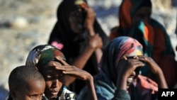 Somali women and children wait for relief supplies from the UN High Commission for Refugees, in Galkacyo, Somaliland, December 2010. (file photo)