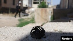 The remains of a cluster bomblet is pictured in the rebel-held town of Dael in Deraa Governorate, Syria, June 27, 2017.