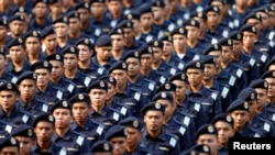 FILE - Members of Malaysia's maritime forces march during National Day celebrations marking the 56th anniversary of the country's independence, at Independence Square in Kuala Lumpur, August 31, 2013.