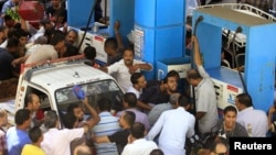 People argue at a petrol station during a fuel shortage in Cairo, June 26, 2013.
