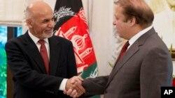 FILE - Pakistani Prime Minister Nawaz Sharif (R) receives Afghan President Ashraf Ghani in Islamabad, Pakistan, Nov. 15, 2014.