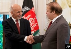 Pakistan's Prime Minister Nawaz Sharif, right, receives Afghan President Ashraf Ghani at the prime minister house in Islamabad, Pakistan, Saturday, Nov. 15, 2014.