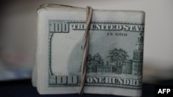 FILE - A view of U.S. dollar bills