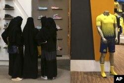 FILE - Saudi women shop at a mall in Riyadh, Dec. 11, 2015.