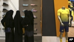 Saudi women shop at a mall in Riyadh. Women across Saudi Arabia marked a historic milestone Saturday, both voting and running as candidates in government elections for the first time.