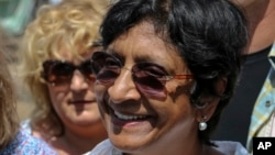FILE - United Nations High Commissioner for Human Rights Navi Pillay visits an undisclosed location in South Sudan in this April 2014 photo released by the United Nations Mission in South Sudan (UNMISS).